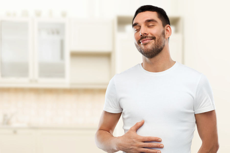 man with a happy tummy | autoimmune conditions and digestive issues | Dr. Negin Misaghi, ND